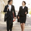Businessman and businesswoman walking — Stock Photo #61033739