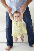 Father playing with baby daughter — Stock Photo