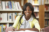 Student working in library — Stock Photo