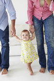 Parents teaching baby to walk — Foto Stock