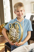 Boy playing French horn — Stock Photo