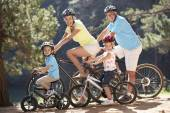 Senior couple with grandchildren on  bike ride — Stock Photo