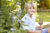 Girl gardening — Stock Photo
