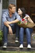 Couple on veranda — Stock Photo