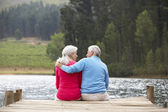 Senior couple on  jetty — Stockfoto