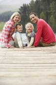 Family on a jetty — Stock Photo