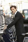 Man using hire bike — Stock Photo