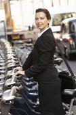Woman using hire bike — Stock Photo