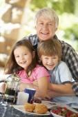 Mid age man and grandchildren — Stock Photo