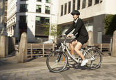 Businesswoman cycling — Stock Photo