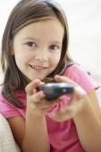 Girl with remote control — Stock Photo