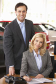 People in car showroom — Stock Photo