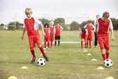 Junior football team training — Stock Photo