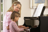 Girl playing piano on lesson — Stock Photo