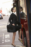 Woman boarding bus — Stock Photo