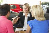 Woman working in car showroom — Stock Photo