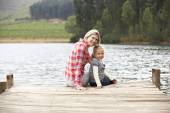 Mother and daughter on a jetty — Stock Photo