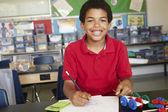 Boy in physics class — Foto Stock