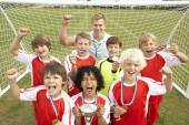 Winning junior soccer team — Stock Photo