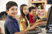 Schoolchildren with computers — Stock Photo