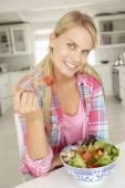 Girl eating salad — Stock Photo