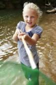 Girl with fishing net — Stock Photo