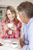 Mid age couple having coffee — Stock Photo