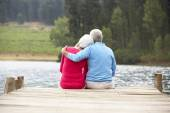 Senior couple on  jetty — Stock Photo