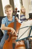 Children  cello and  piano — Stock Photo