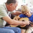 Grandfather with Grandson Play Guitar — Stock Photo #64581747