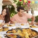 Hispanic Family Enjoying Outdoor Meal — Stock Photo #64581903