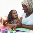 Grandmother Painting Picture With Granddaughter — Stock Photo #64582007