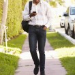 Man Walking Along Street — Stock Photo #64582053