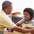 Grandfather Teaching Grandson  Play Guitar — Stock Photo #64582079