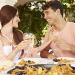 Hispanic Couple Enjoying Outdoor Meal — Stock Photo #64582305