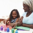 Grandmother Painting Picture With Granddaughter — Stock Photo #64582545
