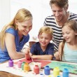 Parents Painting Picture With Children — Stock Photo #64582657