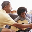 Grandfather Teaching Grandson  Play Guitar — Stock Photo #64582803