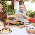Multi Generation Family Making Toast — Stock Photo #64582941