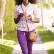 Woman Walking Along Street — Stock Photo #64583125
