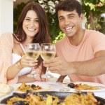Hispanic Couple Enjoying Meal — Stock Photo #64583989