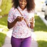 Woman Walking Along Street — Stock Photo #64584121