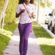 Woman Walking Along Street — Stock Photo #64584501