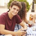 Teenage Boy Using Mobile Phone — Stock Photo #64584605