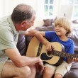 Grandfather with Grandson Play Guitar — Stock Photo #64584683