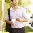 Man Walking Along Street — Stock Photo #64584991