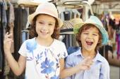 Children Trying On Hats — Stock Photo
