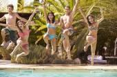Teenage  Jumping Into Swimming Pool — Stock Photo