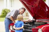 Grandfather And Grandson Working On Car — Stock Photo