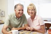 Senior Woman With Husband Baking Cookies — Stock Photo